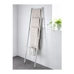 SPRUTT Towel holder - IKEA. We don't have to buy the detachable basket on the bottom and we can use this as a blanket holder in living room as well