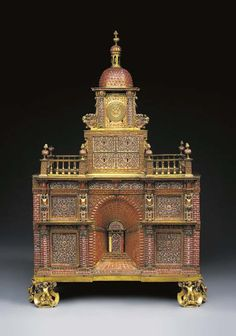 *A SICILIAN CORAL-MOUNTED GILT-BRONZE AND BLUE-AND-WHITE ENAMEL ARCHITECTURAL…