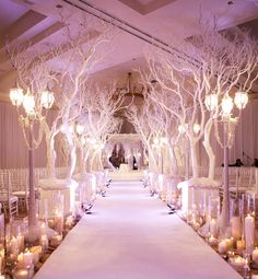 """Someone titled this """"luxury indoor wedding ceremony,"""" but this is pure theatre... or Fashion Runway. Unless the bride wants to light her train on the way down the aisle. That would certainly be memorable."""