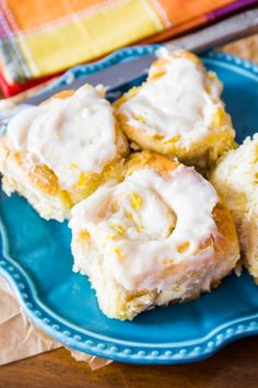 Fluffy & soft lemon sweet rolls covered in a simple lemon cream cheese frosting. These rolls use a quick sweet roll dough – only one rise!