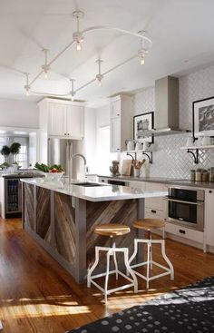 another great kitchen from Sarah Richardson using IKEA cabinets -- love the antique barnboard island, in a herringbone pattern, AND the fabulous vintage industrial light fixture over the island