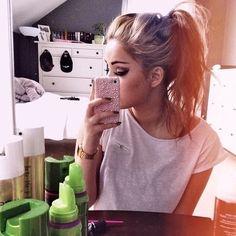 "Messy ponytail: Separate top half/bottom half. Hairspray top half to create ""poof"", tie into ponytail"
