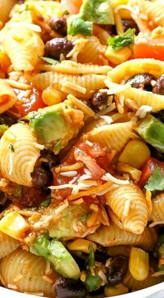 Taco Pasta Salad - great for dinner or side dish! Taco Pasta Salad is a cold Southwest pasta salad recipe filled with black beans, corn, cilantro, avocados, and tomatoes. It's tossed in a vinaigrette and sprinkled with cheese. Mexican Food Recipes, Vegetarian Recipes, Dinner Recipes, Cooking Recipes, Healthy Recipes, Food Recipes Summer, Vegetarian Taco Salad, Sicilian Recipes, Cooking Tips