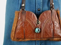 vintage COWBOY BOOT purse by IKAHN on Etsy, $98.00.  OR... I can make my own for a lot less.  : )