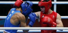 Team GB's Fred Evans in action against Serik Sapiyev in the welterweight final, he won a silver medal
