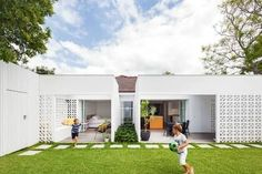Concrete Steppers along house with grass Source: Inside Out magazine
