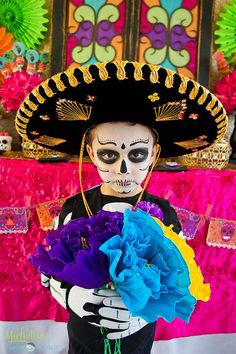 Dress up at a Day of the Dead party! See more party planning ideas at CatchMyParty.com!