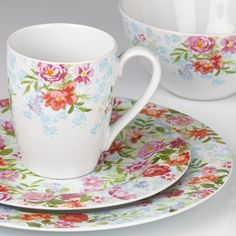 """Bring the bright charm of a flower garden in full bloom right to your table with Kathy Ireland's Spring Bouquet by Gorham. Crafted of stoneware Microwave and dishwasher safe Each place setting includes dinner plate, salad plate, all purpose bowl, and mug. Diameter: dinner plate 11"""", salad plate 8 1/4"""", all purpose bowl 6 1/4"""" Capacity: mug 13 oz."""
