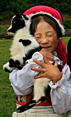 Girl with goat - Yunnan by Elly Prestegaard, via Flickr