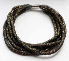 Necklace in a black mesh tube. Handmade seed by MakeYourDaySpecial