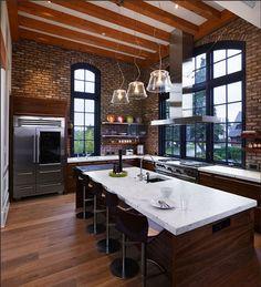 exposed brick, wood floors, exposed slanted beams, huge windows, open shelving, professional gourmet stove, huge island with bar stools... i am smitten.