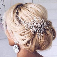 AHH this hair piece is STUNNING! Such a gorgeous wedding updo hairstyle!