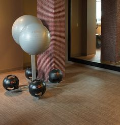 Used under all spaces including cardio machines and weights in the fitness center of the Grand Hyatt Hotel, Chilewich custom tile flooring in Basketweave Latte added a durable and aesthetically pleasing element to the gym.