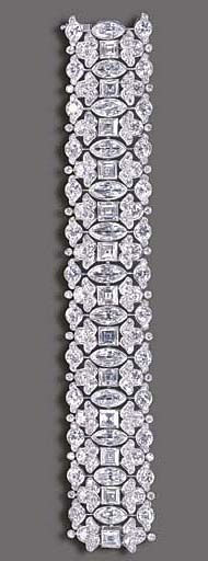 AN ELEGANT DIAMOND BRACELET, BY HARRY WINSTON   The highly flexible wide band, composed of a series of marquise-cut diamonds, each spaced by a square-cut diamond, enhanced by single and old European-cut diamond foliate borders, mounted in platinum, 6½ ins., in a Harry Winston black suede case  Signed Winston for Harry Winston