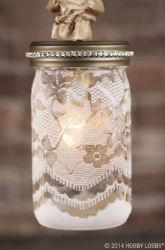 Make your own mason jar light with our easy-to-assemble kits! We used cup chain trim, white spray paint, and lace as a stencil for this design.