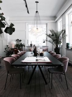 Modern dining room with rose velvet chairs