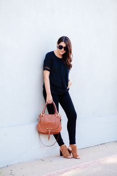Black on black outfit with cognac accessories.