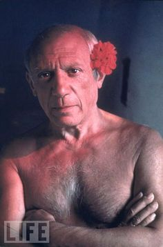 Picasso the Provocateur  Evoking the female flamenco dancers of his native Spain, the 67-year-old artist poses in 1948 with a red flower tucked behind his ear.