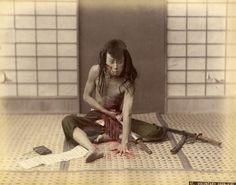 Samurai commiting seppuku (Voluntary Harakiri), ca. 1880