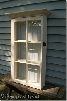 cute window cabinet shelf  (I bought a larger version of this years ago and used it in my kitchen to hold my everyday dishes - and everyone who visited commented on it and loved it!  I still love it after 11 years)