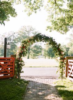 Garden-inspired floral arch: http://www.stylemepretty.com/kentucky-weddings/goshen-kentucky/2016/01/07/chic-stylish-kentucky-horse-farm-wedding/   Photography: Whitney Neal - http://www.whitneynealphoto.com/