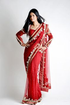 Red Net pearl Saree embellished with pearl,sequel work along the border-An Ideal outfit for function & evening parties paired with Heavy Earrings.....wow it is !!!!