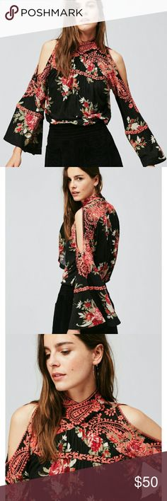 Free people cold shoulder top Hard to show on in pictures that's why I added images, worn once. Free People Tops Blouses