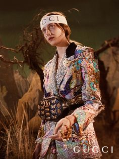 Floral embroidered iridescent jacket and GG Marmont belt bag with metal studs in animal forms from Gucci Fall Winter 2017.
