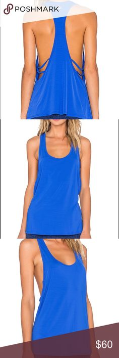 Beyond Yoga Blue Strappy Back Tank Top Worn less than a handful of times. Beautiful, soft, vibrant blue tank top. Perfect for the gym or even wearing with a pair of shorts! Beyond Yoga Tops Tank Tops