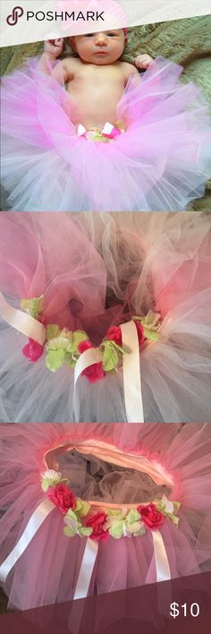 Pink tutu with roses We used this tutu for my daughter's newborn photo session, but never used again.  It was too big then, but we laid her in it. Bottoms Skirts