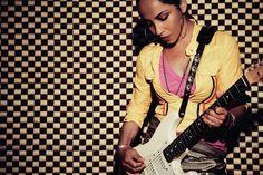 Sade Adu .. hoop earrings .. guitar