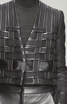 Black jacket with woven structure; fabric manipulation; weaving; close up fashion detail // David Koma Fall 2014