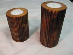 Candle holders - Pine turned on lathe, burnt with gas flame, brushed with steel brush an sealed wit PU