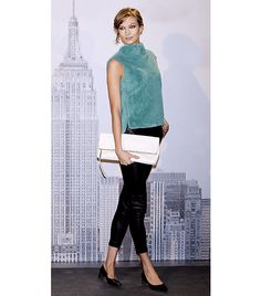 @Who What Wear - Karlie Kloss                 Tip: Textured Top + Leather Leggings  On Kloss: Coach Rex Rabbit Sleevless Tunic ($1298); Coach Leather High Waisted Trousers ($1298); Coach Large Clutchable Bag ($458); Coach Leigh Heels ($258)  Get The Look: Topshop Fluffy Crop Tee ($56); Blank Pussy Cat Faux-Leather Leggings ($98)