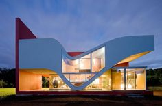 This modern single family home on the island of St. Miguel in the Azores, Portugal has a very unique design by Bernardo Rodrigues Arquitecto. The shape of the house is inspired by the wind, the climate and the natural environment of the region. The idea is to bring the outside inside regardless of the weather condition. The house is a collection of stacked structures that is both functional and a freedom of expression.