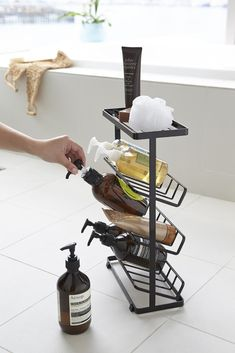 Looking to maximize your shower storage? These unique shower organization tools can help you restore a spa-like feeling to your shower—no matter its size. Shower Shelves, In Shower Storage, Clever Bathroom Storage, Shower Caddies, Shower Rack, Bathroom Caddy, 1950s Bathroom, Bathroom Niche, Bronze Bathroom