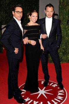 2011 - Robert Downey Jr with his wife, film producer Susan Downey, and Jude Law