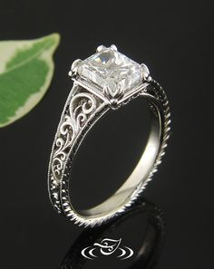 Custom #antique style ring in white gold with leaf prongs, scroll pattern and filigree, and a radiant cut diamond center. #GreenLakeJewelry