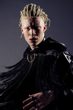 Male fashion editorial photoshoot with Shaun Ross by Katya Tsyganova for Rolling Stone magazine (Russia) wearing Ashton Michael black leather top