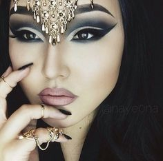 Makeup ((this is beautiful.. a lot of make-up tho.))