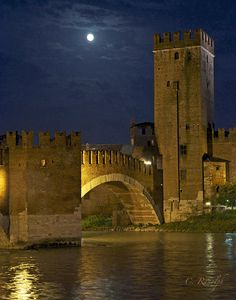 Castlevecchio (Old Castle) in Verona, Italy under a full moon. The castle was constructed between 1354-1356