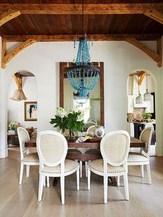 Turquoise chandelier plays well with creamy neutrals