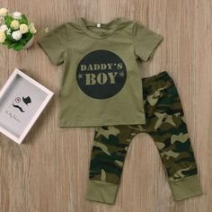 Camouflage themed set perfect for your little daddy's boy Olive round neck shirt Camouflage printed pants with elastic waist band Made with premium cotton blend SIZE CHART: SIZE Top Length (cm) Bust x 2 (cm) Pants Length (cm) 0-6 Months 32 24 38 6-12 Months 34 25 42 12-18 months 36 26 46 18-24 months 38 27 50 WHAT'S INCLUDED: 1 x Daddy's Boy shirt 1 x Daddy's Boy pants Camouflage Baby, Camouflage T Shirts, Camouflage Outfit, Baby Outfits, Newborn Outfits, Toddler Outfits, Kids Outfits, Baby Set, Teenager Mode