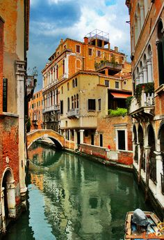 Venetian canal. Imagine basking in the warm heat of italian sun and gliding down in a gondola.