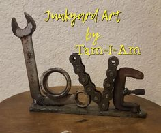 "Junkyard Art by Tam-I-Am. ""Love"" is all you need. Scrap metal art."