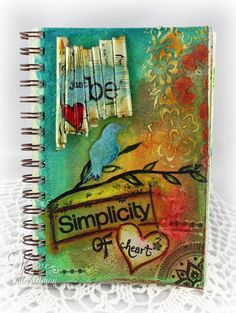 5.5 x 8 art journal page using gelatos, distress stains, molding paste and rolled paper.