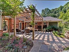 Pergula with stone patio...