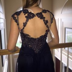 Jovani Prom/ Evening gown Never worn. Never tailored!!! Navy blue long dress, no rips tears or missing jewels. Open back and mesh chest. Dress bag from Castle Couture is included! Jovani Dresses Prom