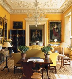 This buttery yellow room works really well with the darker antique paintings and screen. Gorgeous!