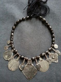 Moroccan pendants and black coral from Yemen. By Carla Alicata.